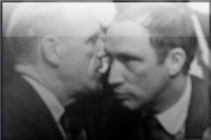 Mitchell Sharp whispering in the ear of Pierre Elliott Trudeau at the 1967 Liberal Leadership Convention