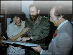 Cuban President Fidel Castro an Pierre and Margaret Trudeau look over a photo album during their state visit to Cuba in this January, 1976 photo (CP)