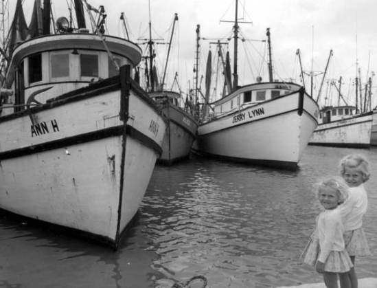 Two girls standing in front of shrimp boats - Key west, Florida. Two girls standing in front of shrimp boats - Key west, Florida.